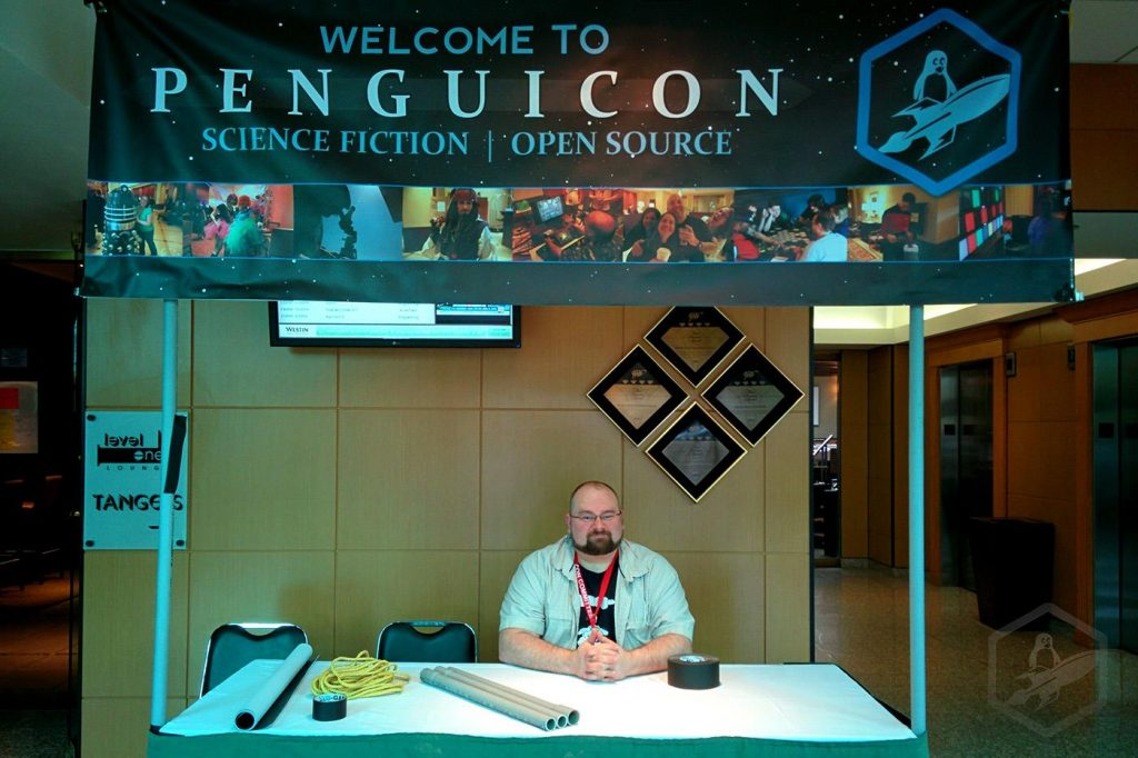 Penguicon greeter desk